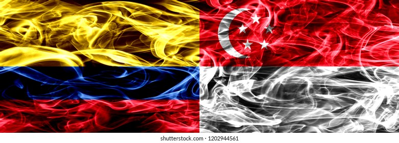 Colombia vs Singapore, Singaporean smoke flags placed side by side. Thick colored silky smoke flags of Colombian and Singapore, Singaporean