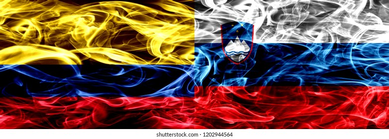 Colombia vs Slovenia, Slovenian smoke flags placed side by side. Thick colored silky smoke flags of Colombian and Slovenia, Slovenian