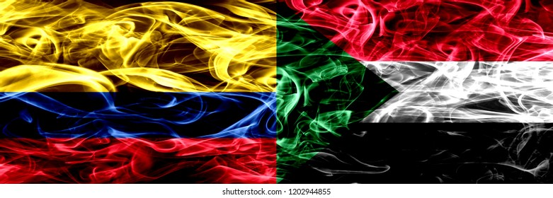 Colombia vs Sudan, Sudanese smoke flags placed side by side. Thick colored silky smoke flags of Colombian and Sudan, Sudanese