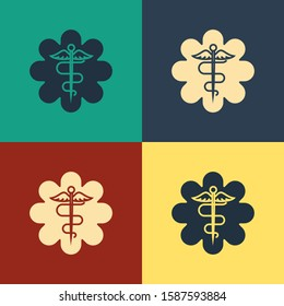 Color Emergency star - medical symbol Caduceus snake with stick icon isolated on color background. Star of Life. Vintage style drawing.