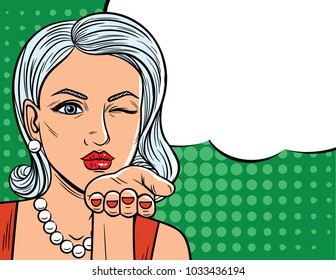 Color illustration in comic art style of  pretty woman with winking eye. Glamour lady with blonde hair sending a flying kiss over halftone dot background