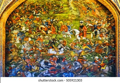 Color Painting Beautiful Ancient Traditional Medieval Persian Mural Wall Painting of Battle of Chaldiran at Chehel Sotoun Palace in Isfahan, Iran on Sandstone Texture