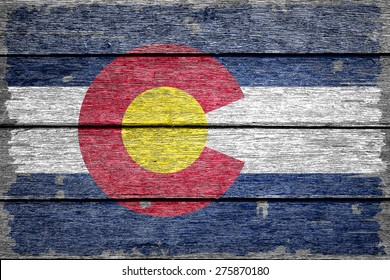 Colorado flag on old wood texture background