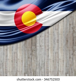 Colorado flag of silk with copyspace for your text or images and wood background