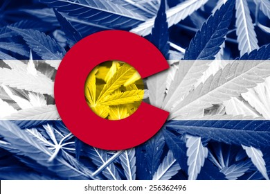 Colorado State Flag on cannabis background. Drug policy. Legalization of marijuana