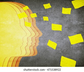 colored human head silhouette and flying post it memory concept