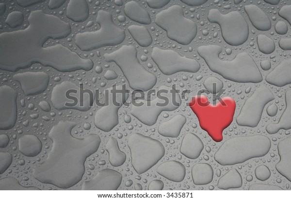 colored water drop in heart shape on metal background