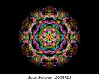 Colorful abstract flame mandala flower, neon ornamental floral round pattern on black background. Yoga theme.