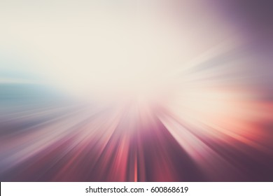 COLORFUL ABSTRACT MOTION BLURRED BACKGROUND, SPEED LINES ON THE EMPTY ROAD