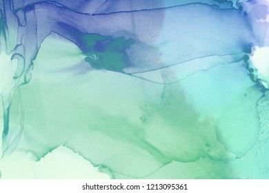 Colorful alcohol ink wash texture on white paper background. Liquid paint flow. Transparent ethereal effect.