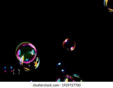 Colorful bubbles circles abstract on black background illustration