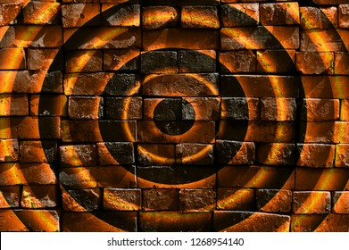 Colorful concentric hypnotic circles. Virtual graffiti. Abstract image, drawn on a photo of a brick wall. Digital graphics by Igor Mishenev (artist-abstractionist).