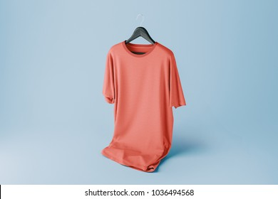 Colorful Creative red t-shirt Mockup with hanger on blue background. 3D rendering