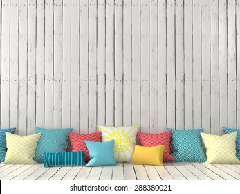 Colorful cushions on the background of a wall with white boards
