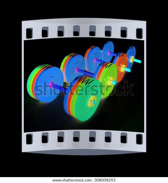 Colorful dumbbells on a black background. The film strip