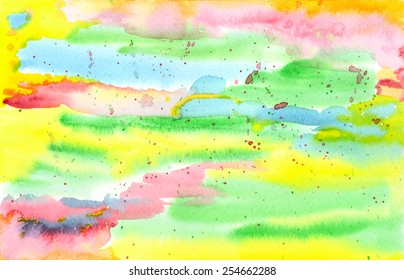 Colorful, hand-painted abstract watercolor background texture in bright rainbow tones of red, yellow, green and blue.