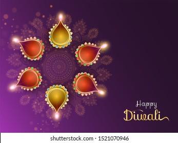 Colorful illuminated oil lamp (diya) on purple rangoli background for Happy Diwali festival poster or greeting card design.