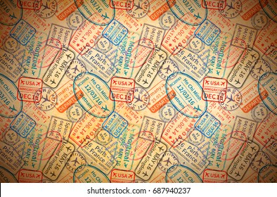 A lot of colorful International travel visa rubber stamps imprints on old paper, horizontal vintage background