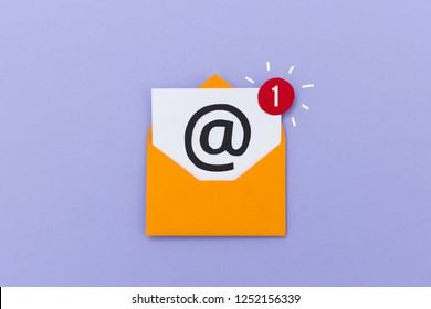 Colorful opened envelope with electronic mail letter showing one new message on purple background