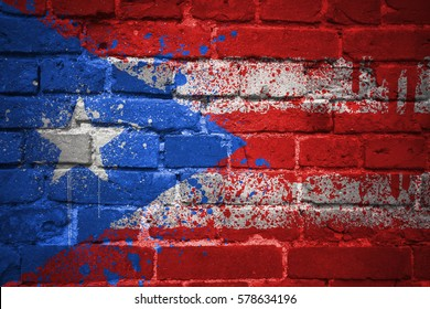 colorful painted national flag of puerto rico on a old brick wall