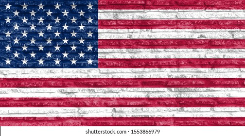 Colorful painted national flag of USA on a old brick wall.