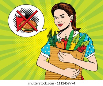 Colorful pop art style illustration of a young beautiful lady with full paper bag of vegetables and forbedden sign of junk food. Happy beautiful woman doing health grocery shopping
