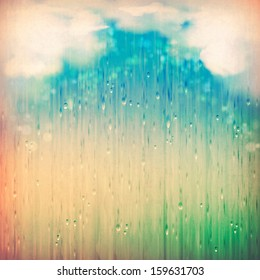 Colorful rain. Vintage abstract grange rainy landscape background. Clouds, water, rain drops, blurred lights on the textured old paper in retro style. Natural sky artistic wallpaper design