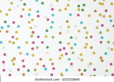 Colorful rounded paper carnival confetti abstract illustration isolated on colored backgroud.