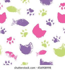 Colorful seamless pattern with paw footprints, cat's heads and fish. Cute hand drawn steps and snouts drawn with watercolors. Bright texture for consumer industry design
