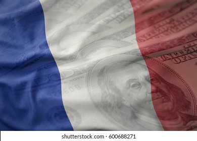 colorful waving national flag of france on a american dollar money background. finance concept