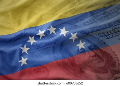 colorful waving national flag of venezuela on a american dollar money background. finance concept