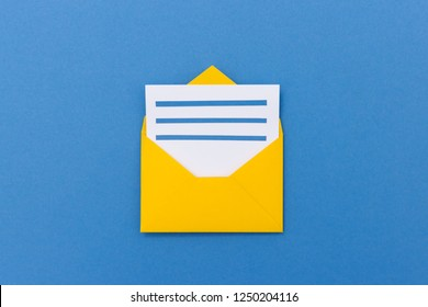 Colorful yellow paper envelope with new letter on blue background