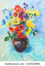 Coloufull flowers in ceramic vase on blue cloth