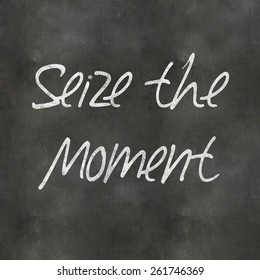 A Colourful 3d Rendered Concept Illustration showing Seize the Moment written on a Blackboard
