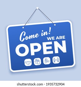 Come in open sign. New normal welcome signage for shop or market reopen during covid 19 with safety icons. Hanging on door  blue tag