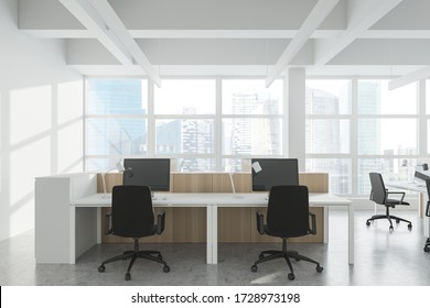 Comfortable workplace in Industrial style office with white walls, concrete floor, rows of computer tables and panoramic window with blurry cityscape. 3d rendering