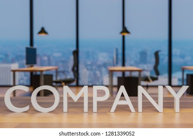 company logo on clean wooden desk in modern office with skyline view 3d rendering