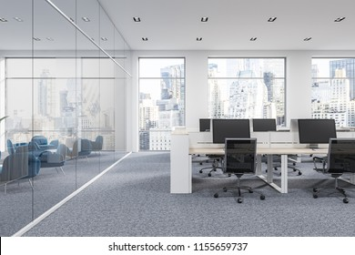 Company office corner with a gray carpet and rows of white computer tables. Industrial style interior with white walls and large windows with a cityscape. Front view. 3d rendering mock up