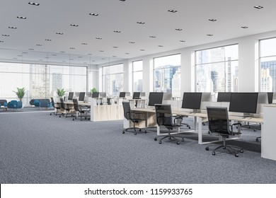Company office corner with a gray carpet and rows of white computer desks. Industrial style interior with white walls and large windows with a cityscape. 3d rendering mock up