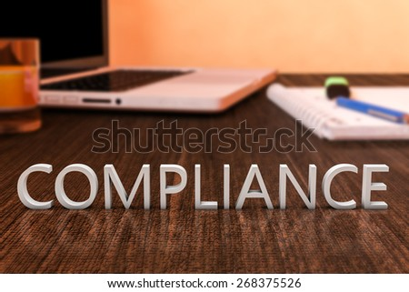 Compliance - letters on wooden desk with laptop computer and a notebook. 3d render illustration.