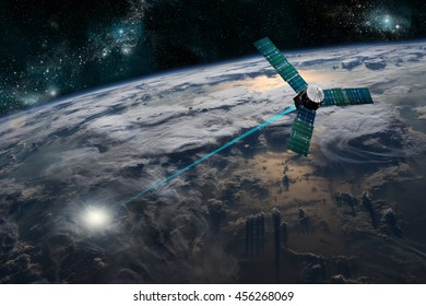 A composite image of a satellite firing an energy weapon at a target on Earth - Elements of this image furnished by NASA.