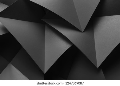 Composition with gray paper folded in geometric shapes, illustration, macro image