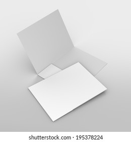 composition of two white folders on grey