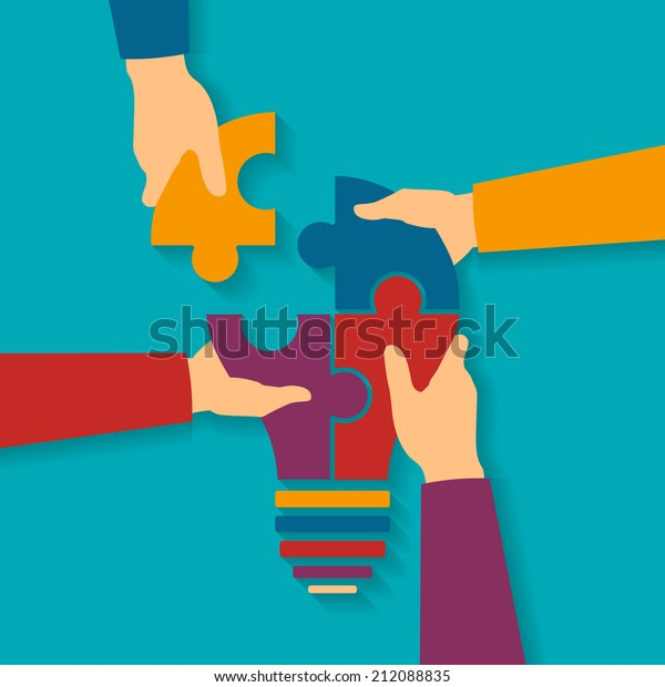 Concept of creative teamwork with light bulb puzzle and human hands