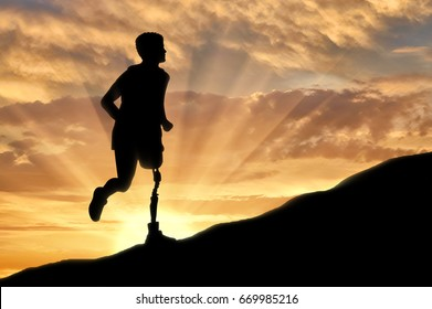 Concept of disability. Man with prosthetic leg running up the hill