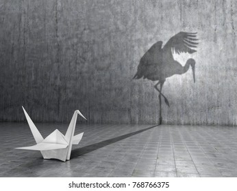 Concept of hidden potential. A paper crane that throws the shadow of a real crane. 3D illustration