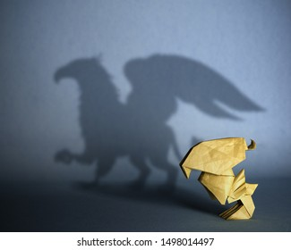 Concept of hidden potential. A paper figure of a chicks  that fills the shadow of a griffin. 3D illustration
