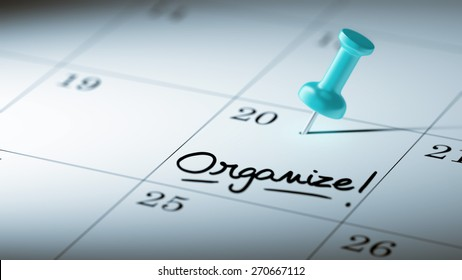 Concept image of a Calendar with a blue push pin. Closeup shot of a thumbtack attached. The words Organize written on a white notebook to remind you an important appointment.