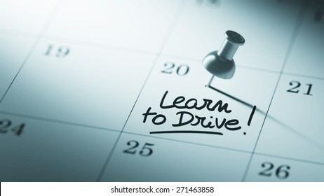 Concept image of a Calendar with a push pin. Closeup shot of a thumbtack attached. The words Learn to Drive written on a white notebook to remind you an important appointment.