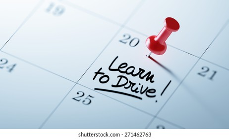 Concept image of a Calendar with a red push pin. Closeup shot of a thumbtack attached. The words Learn to Drive written on a white notebook to remind you an important appointment.